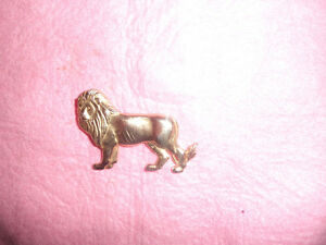 "2"" lion pin metal, exc. cond. 4.00"