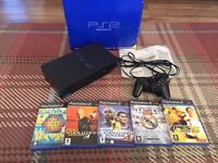 Boxed PlayStation 2, with controller and games bundle