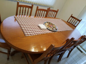 Solid Oak Oval Kitchen table set with 8 chairs..never used!!