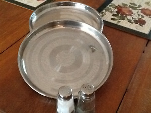 Six stainless steel thali dishes