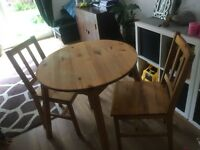 Solid pine table and 2 matching chairs £40 ono