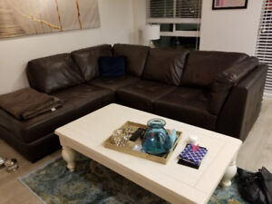 Brown leather sectional couch