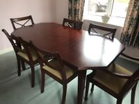 Mahogany dining table and six chairs with extender