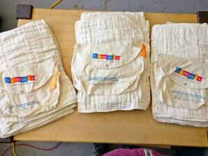 Barely used Bummis prefold diapers and assorted diaper covers