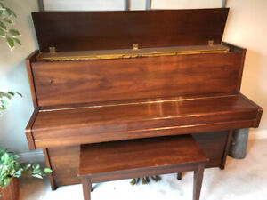 Yamaha upright piano -  excellent condition .