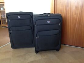 """Set of two black suitcases 28"""" &24"""" by American Tourister"""