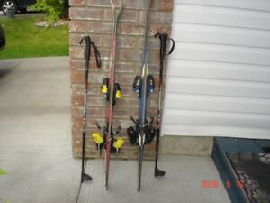 Two sets of skis and 2 sets of poles, 1 pair boots