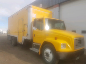 Freightliner service truck set up with welder and tool box
