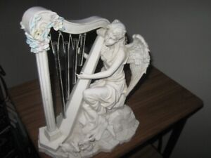 LOVELY  ANGLE PLAYING A HARP