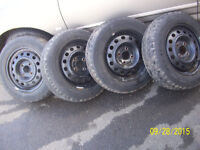 (4) winter tires 185/65r15  Mounted on honda rims