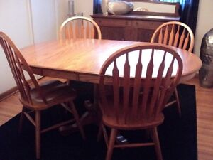 Solid Oak pedestal table & 4 chairs
