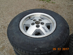 P235 70R15 Tires and rims.