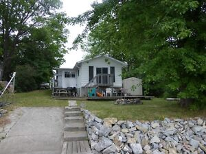 NEW PRICE Mississippi lake Waterfront West facing cottage/home