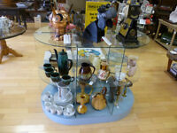 Oval glass and wood display unit