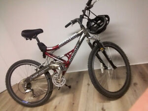 24 speed Shimano mountain bike with helmet and lock
