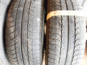Two Michelin 255 60 19 X-ice tires