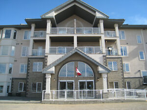 Beautiful 2 Bdr Condo in MacEwan with 2 U/G Parking Stalls