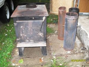 air tight certified wood stove,with couple pipes.$350.