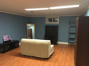 $200 off first month! Partially furnished semi private basement