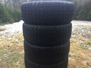Four 215/50R17 Studded Winter Tires Excellent Tread