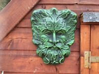 Concrete green man face