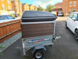 Erde 102 Trailer with roof box