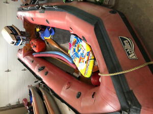 14' (zodiac type)  inflatable with 25hp Evinrude