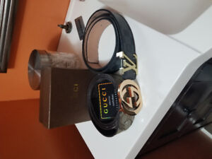 Gucci belt approx size 38 waist or less and Louie Vutto