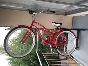 Red Electra ladies cruiser bike with verticle stand!