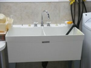 Laundry tub hard plastic with chrome faucet