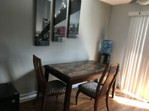 Marble kitchen table and two real wood zebra chairs