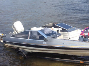 Bayliner boat with Johnson motor and trailer and also water ski