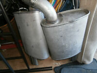 2 ford mufflers could be for a truck left by owner of house aski