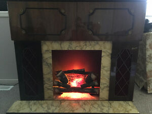 Fire Place With AM/FM Radio and Side Bar