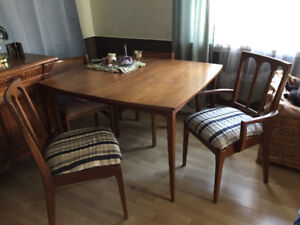 Cherry wood dining table and 4 chairs. 1 is an arm