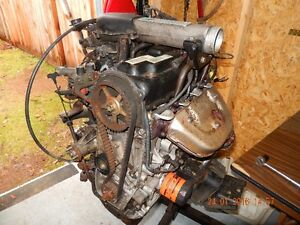 Suzuki engine, transmission & complete rear end,