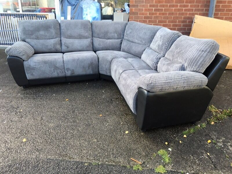 Ex high st grey jumbo cord fabric designer curved corner sofa black leather