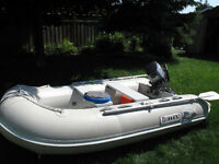 2007 8 hp Yamaha with 8.5 foot inflatable