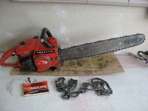 "Homelite xl 76 58cc chain saw w 20"" bar and 3 chains"