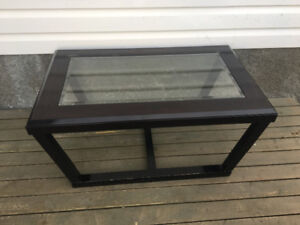 Dark brown glass coffee table forsale