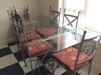 Glass table and 6 chairs.