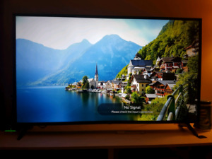 LG UHD 4K HDR TV + stand
