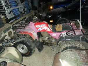 Honda 300 4  trax parted  out both of them are  !!