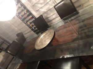 Glass top dining table with two pedestals