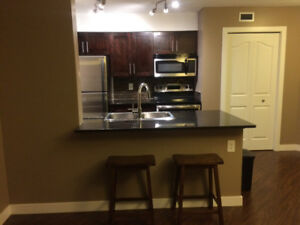 SW, Rutherford 2 BR Condo With Heated UG Parking & Storage