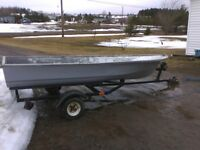 Reduced to $800.00 obo.  Light Fiberglass boat and trailer