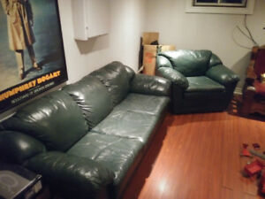 Dark green leather couch and chair in good condition.
