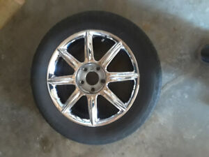 Aluminum wheels for sale with tires.