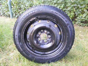 Four Goodyear Nordic Snow Tires and Steel Wheels