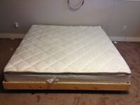 Brand new king size mattress , wooden box frame included